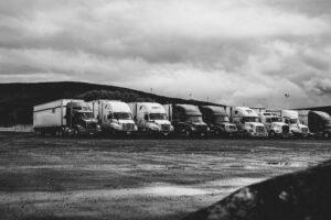 line of big rig trucks